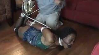 Sexy black girl in pantyhose ball gagged and neck hogtied